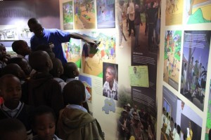 Primary pupils attended the exhibition. Here a NAR staff is guiding them